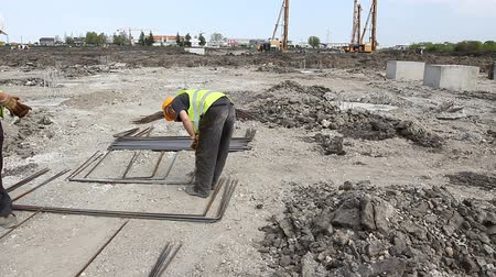 ayrılmış : Zrenjanin, Vojvodina, Serbia - April 23, 2015: Worker is measuring the length of reinforcing steel, armature at construction site. Stok Video
