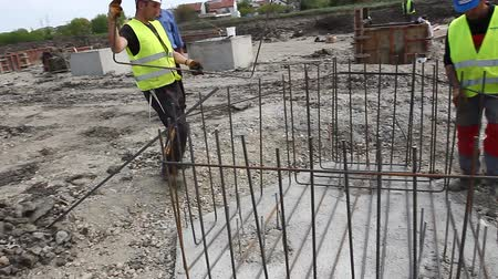 fitter : Zrenjanin, Vojvodina, Serbia - April 23, 2015: Workers are tying rebar to make a newly constructed footing frame. Binding concrete frame
