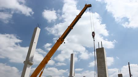 reinforced concrete : Mobile crane is lifting concrete joist Mobile crane is unloading concrete joist from truck trailer. Stock Footage