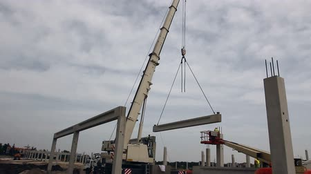 telescopic : Mobile crane is operating and lifting concrete joist Mobile crane is unloading concrete joist from truck trailer. Stock Footage