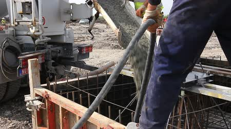 fitter : Zrenjanin, Vojvodina, Serbia - April 30, 2015: Workers at building site are pouring concrete in mold from mixer truck. Stock Footage
