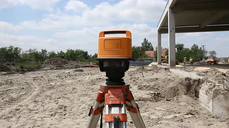 geodesy : Zrenjanin, Vojvodina, Serbia - May 29, 2015:Red laser is leveling device central device to level construction site. Stock Footage