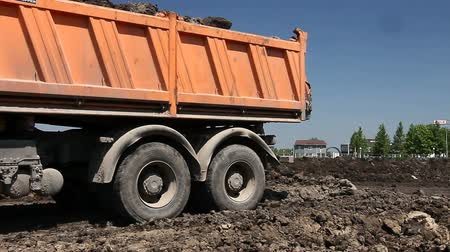 fazla : Zrenjanin, Vojvodina, Serbia - May 30, 2015: Dumper trucks are unloading soil or sand at construction site.