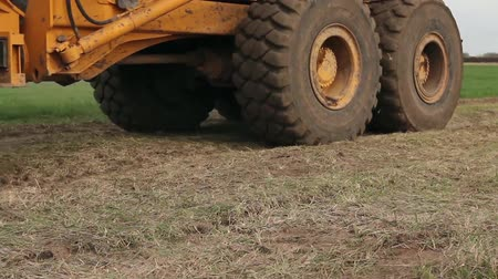 гражданский : Close up view on dump truck undercarriage during passing by at construction site. H.264 video codec