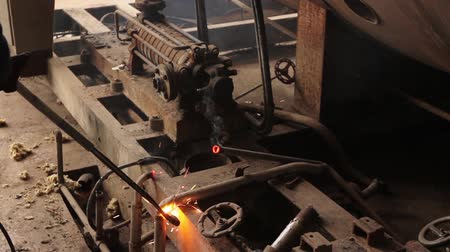 smaltimento : Worker is cutting manually old, scrap, metal construction using gas mixture of oxygen and acetylene, propane. H.264 video codec