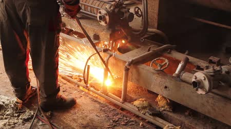poros : Worker is cutting manually old, scrap, metal construction using gas mixture of oxygen and acetylene, propane. H.264 video codec