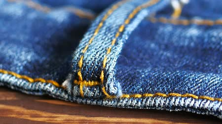 western wear : Close up detail of blue denim jeans belt loop texture background