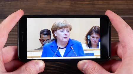 Ternopil, Ukraine - February 19, 2018: looks at the Angela Merkel on smartphone Wideo