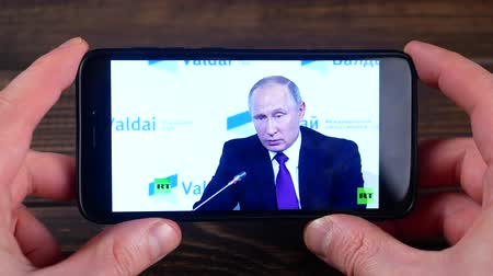 Ternopil, Ukraine - February 19, 2018: looks at the Russian President Vladimir Putin on smartphone