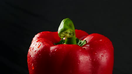 peper : Sweet red pepper on black background close up