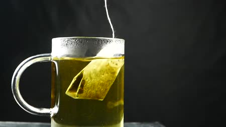 teabag : Tea bag in the cup with hot water