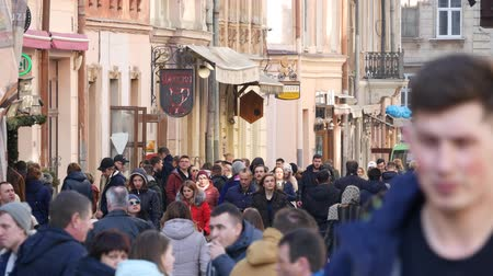 Ukraine, lviv - may 16: City pedestrian traffic shot on a busy lviv shopping street with added color correction Wideo