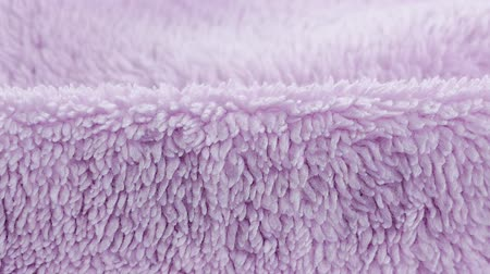 piled : Terry lilac colored cloth towel texture as a background Stock Footage