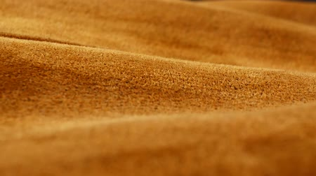 camurça : Old aged suede leather background. Coarse texture, gradient yellow brown beige, vivid colors.