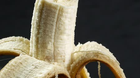 compelling : Banana skin extreme close up stock footage. Banana skin surface in macro close up with a sliding camera move