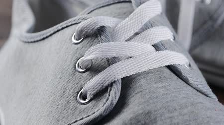 Man casual boots details close-up - Male shoes laces and snitches slow tilting