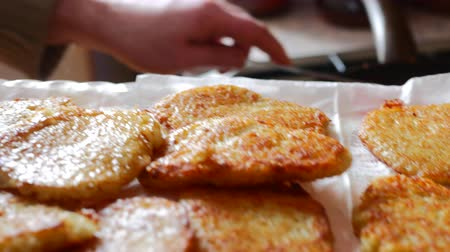 roston sült : cook of golden crispy potato pancakes in a frying pan