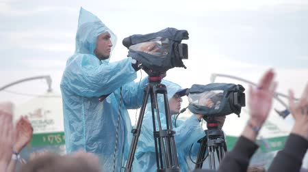 UKRAINE, TERNOPIL - July 20, 2018: Video camera operator working with his equipment at outdoor event, Cameraman