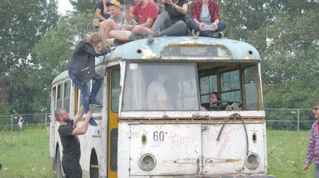 UKRAINE, TERNOPIL - July 20, 2018: Young crowd of teenagers dancing at a music festival in summer on a old retro trolleybus Wideo