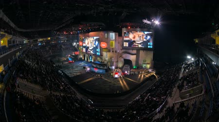 serpentyny : MOSCOW, RUSSIA - OCTOBER 27 2018: EPICENTER Counter Strike: Global Offensive esports event. Main stage, lightning, illumination, big screen with game moments from overlooking spot at the top.