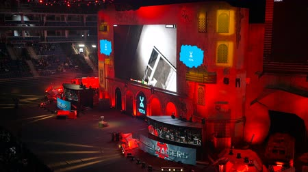 counter strike : MOSCOW, RUSSIA - OCTOBER 27 2018: EPICENTER Counter Strike: Global Offensive esports event. Main stage with a big screen showing the game and player booths.