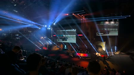 forma : MOSCOW, RUSSIA - OCTOBER 27 2018: EPICENTER Counter Strike: Global Offensive esports event. Colorful main stage venue with lot of illumination, lights. Tribunes full of visitors and fans.