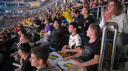 counter strike : MOSCOW, RUSSIA - OCTOBER 27 2018: EPICENTER Counter Strike: Global Offensive esports event. Fans on a tribunes with posters clapping hands and supporting their favorite team.