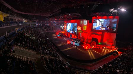 MOSCOW, RUSSIA - OCTOBER 27 2018: EPICENTER Counter Strike: Global Offensive esports event. Main stage, lightning, illumination, big screen with a game moments on it. Stage pulse with a red light. Stok Video