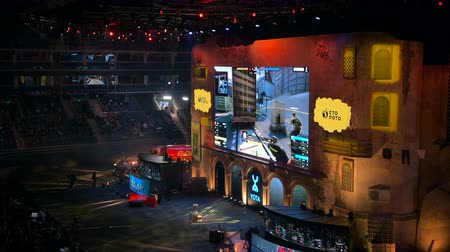 MOSCOW, RUSSIA - OCTOBER 27 2018: EPICENTER Counter Strike: Global Offensive esports event. Main stage with a big screen showing the game and player booths.