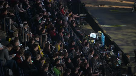 atirador : MOSCOW, RUSSIA - OCTOBER 27 2018: EPICENTER Counter Strike: Global Offensive esports event. Fans on a tribunes cheering and supporting for thier favorite teams. Stock Footage