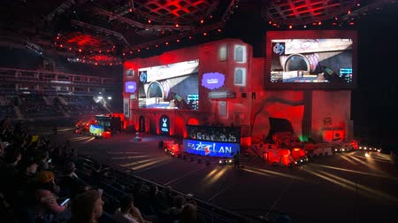 forma : MOSCOW, RUSSIA - OCTOBER 27 2018: EPICENTER Counter Strike: Global Offensive esports event. Entering the arena with big screen on a stage. Fans on a tribunes cheering and supporting for favorite teams.