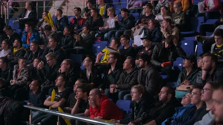 MOSCOW, RUSSIA - OCTOBER 27 2018: EPICENTER Counter Strike: Global Offensive esports event. Fans on a tribunes cheering and supporting for thier favorite teams. Stok Video