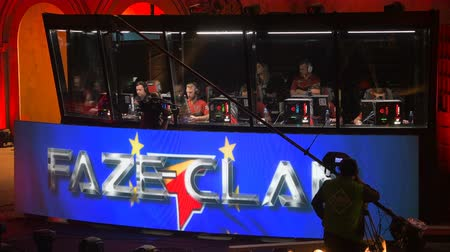 MOSCOW, RUSSIA - OCTOBER 27 2018: EPICENTER Counter Strike: Global Offensive esports event. Players booth with team FAZE clan inside on a stage.