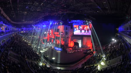 counter strike : MOSCOW, RUSSIA - OCTOBER 27 2018: Counter Strike: Global Offensive esports event. Timelapse video of Introduction of Natus Vincere NaVi team. Main stage, lightning, illumination, big screen
