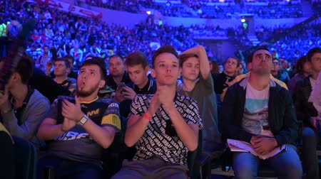 MOSCOW, RUSSIA - 14th SEPTEMBER 2019: esports Counter-Strike: Global Offensive event. Fans on a tribunes cheering and supporting for thier favorite teams.