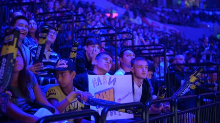flama : MOSCOW, RUSSIA - 14th SEPTEMBER 2019: esports Counter-Strike: Global Offensive event. Little sad boy on a tribunes on a tournaments arena. Video gamees fans cheering for their favorite team during the match. Stok Video