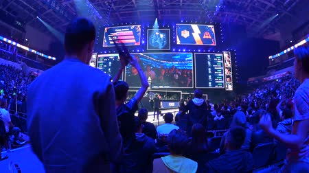 counter strike : MOSCOW, RUSSIA - 14th SEPTEMBER 2019: esports Counter-Strike: Global Offensive event. Happy dedicated fans at arena. Cheering with a hands raised. Stock Footage