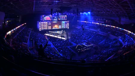 flama : MOSCOW, RUSSIA - 14th SEPTEMBER 2019: esports Counter-Strike: Global Offensive event. Fans on a tribunes cheering and supporting for thier favorite teams.