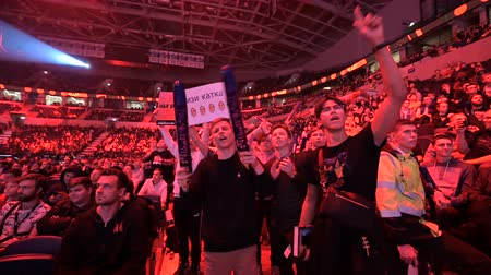 torcendo : MOSCOW, RUSSIA - 14th SEPTEMBER 2019: esports Counter-Strike: Global Offensive event. Dedicated enthusiastic fans at arena cheering and worried about their favorite team.