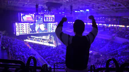MOSCOW, RUSSIA - 14th SEPTEMBER 2019: esports Counter-Strike: Global Offensive event. Happy dedicated fan at arena. Cheering with a hands raised. Stok Video