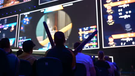 стример : MOSCOW, RUSSIA - 14th SEPTEMBER 2019: esports Counter-Strike: Global Offensive event. Fans on a tribunes cheering and supporting for thier favorite teams.