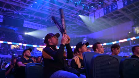 MOSCOW, RUSSIA - 14th SEPTEMBER 2019: esports Counter-Strike: Global Offensive event. Dedicated enthusiastic fans at arena cheering and worried about their favorite team.