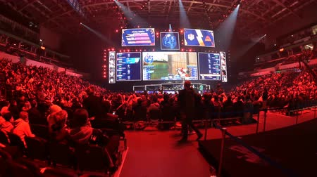 MOSCOW, RUSSIA - 14th SEPTEMBER 2019: esports Counter-Strike: Global Offensive event. Overview stabilized shot of arena, players booths, big screens and tribunes.