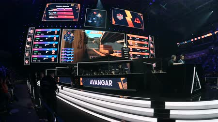 부채 : MOSCOW, RUSSIA - 14th SEPTEMBER 2019: esports Counter-Strike: Global Offensive event. Overview stabilized shot of arena, players booths, big screens and tribunes.