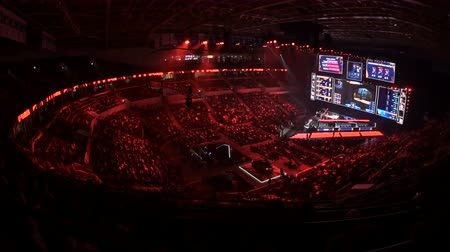 counter strike : MOSCOW, RUSSIA - 14th SEPTEMBER 2019: esports Counter-Strike: Global Offensive event. Main stage with a big screen showing the matchs game moments. Arena lit with a red color.