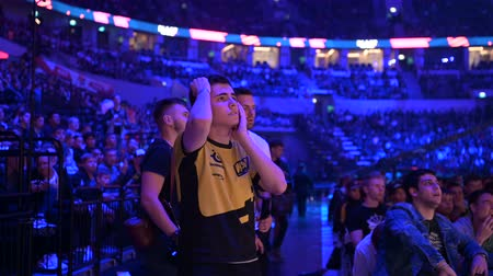 counter strike : MOSCOW, RUSSIA - 14th SEPTEMBER 2019: esports gaming event. Dedicated enthusiastic fan at arena cheering and worried about his favorite team. He is very sad about his team losing.