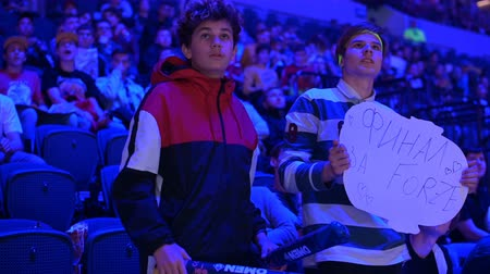 néző : MOSCOW, RUSSIA - 14th SEPTEMBER 2019: esports gaming event. Dedicated enthusiastic fans at arena worry about their favorite team. They are very sad about their team losing.