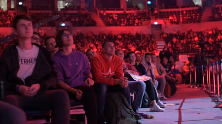 torcendo : MOSCOW, RUSSIA - 14th SEPTEMBER 2019: esports Counter-Strike: Global Offensive event. Stabilized shot of arena, fans on a tribunes.