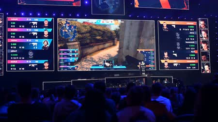 MOSCOW, RUSSIA - 14th SEPTEMBER 2019: esports Counter-Strike: Global Offensive event. Main stage venue, players booths, big screen with a game moments on it.