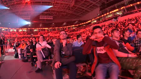 MOSCOW, RUSSIA - 14th SEPTEMBER 2019: esports Counter-Strike: Global Offensive event. Video games fans showing their love and cheering for their favorite team during the match.